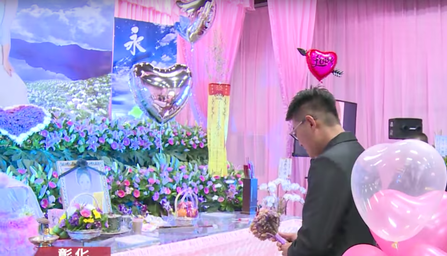 Taiwanese man gets engaged to dead girlfriend at funeral: report