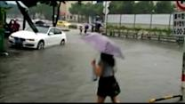 Woman falls into deep floodwaters