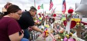 People place flowers at a makeshift memorial for shooting victims at the Cielo Vista Mall Walmart, in El Paso, Texas, on August 6, 2019. (Getty Images)