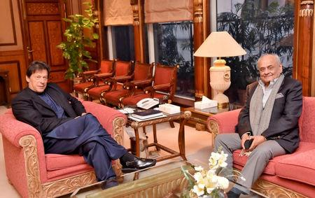 Brigadier Ijaz Ahmed Shah, Minister of the National Assembly, meets with Prime Minister Imran Khan at the Prime Minister Office in Islamabad