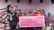 Multi-Platinum Recording Artist, Andy Grammer and AutoNation Present Check to the Breast Cancer Research Foundation at the 2018 AutoNation Cure Bowl