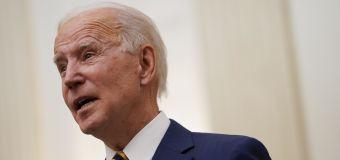 Biden to reinstate travel restrictions to curb virus