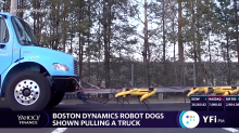 Rise of the robots: robot dogs shown pulling a truck in formation