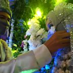 You may NOT kiss the bride! Couple weds in masks during pandemic