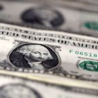 Stimulus hopes press dollar to one-month low; yuan soars