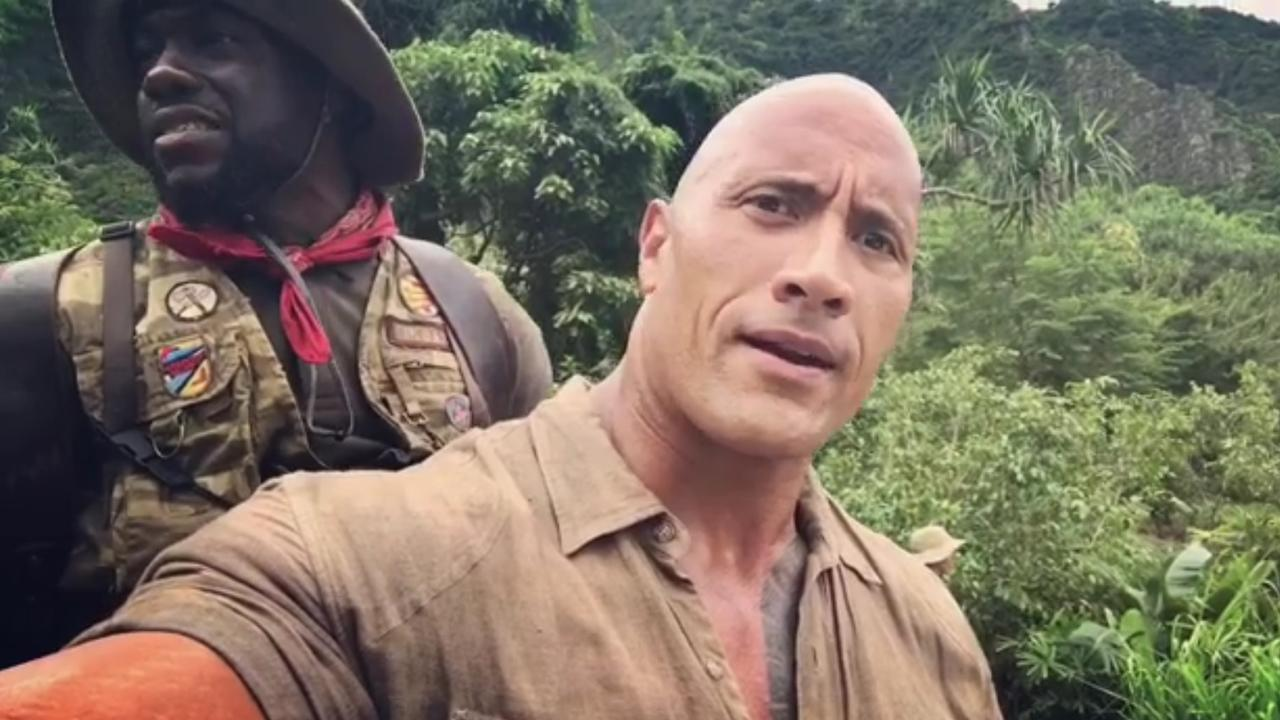 Dwayne Johnson and Kevin Hart Get Uncomfortably Close While Filming 'Jumanji'