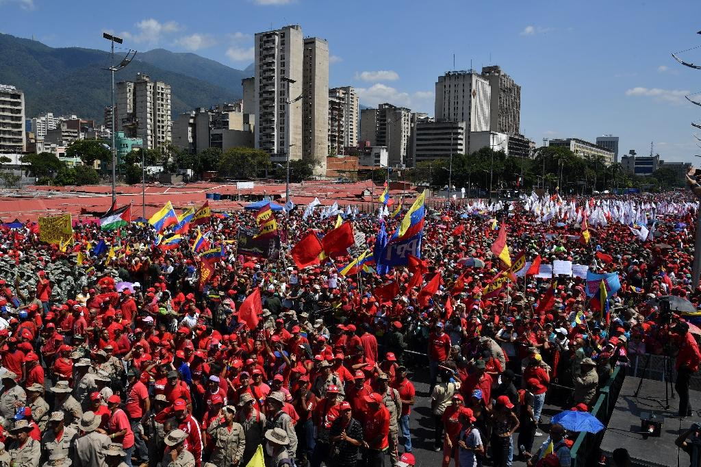 Tens of thousands of people turned out Saturday for competing shows of support for Guaido and for Maduro (AFP Photo/Yuri CORTEZ)