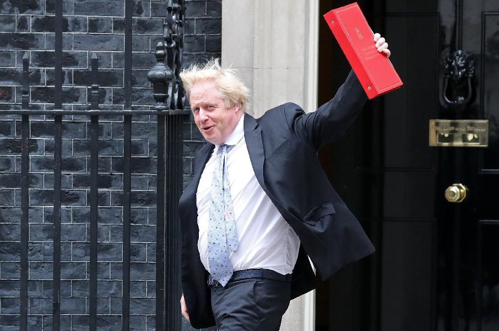 Foreign Secretary Boris Johnson waves as he leaves 10 Downing Street in after a cabinet meeting in London on June 5, 2018