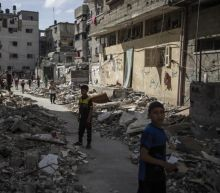 In Gaza, children hide and buildings fall from Israeli airstrikes