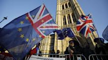 Theresa May tries to salvage Brexit deal after delaying parliamentary vote