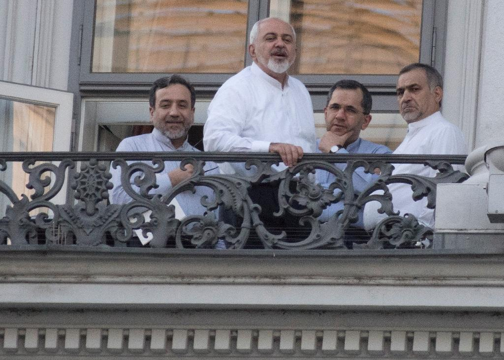 (L-R) Iranian officials Abbas Araqchi, Mohammad Javad Zarif, Majid Takht-Ravanchi and Hossein Fereydoun stand on a balcony at the Palais Coburg Hotel in Vienna on July 11, 2015