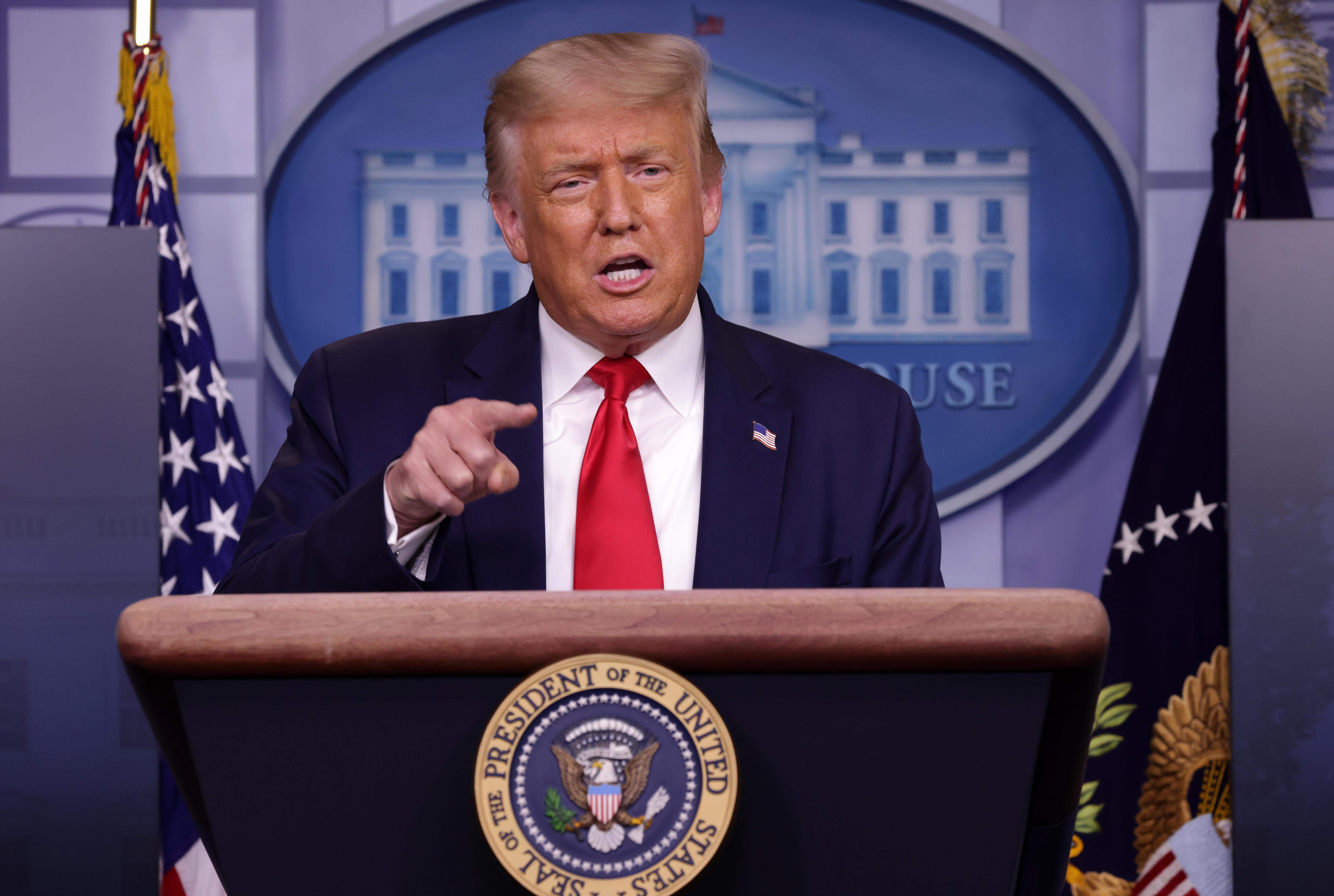 "Trump says coronavirus is ""receding"" even as deaths rise"