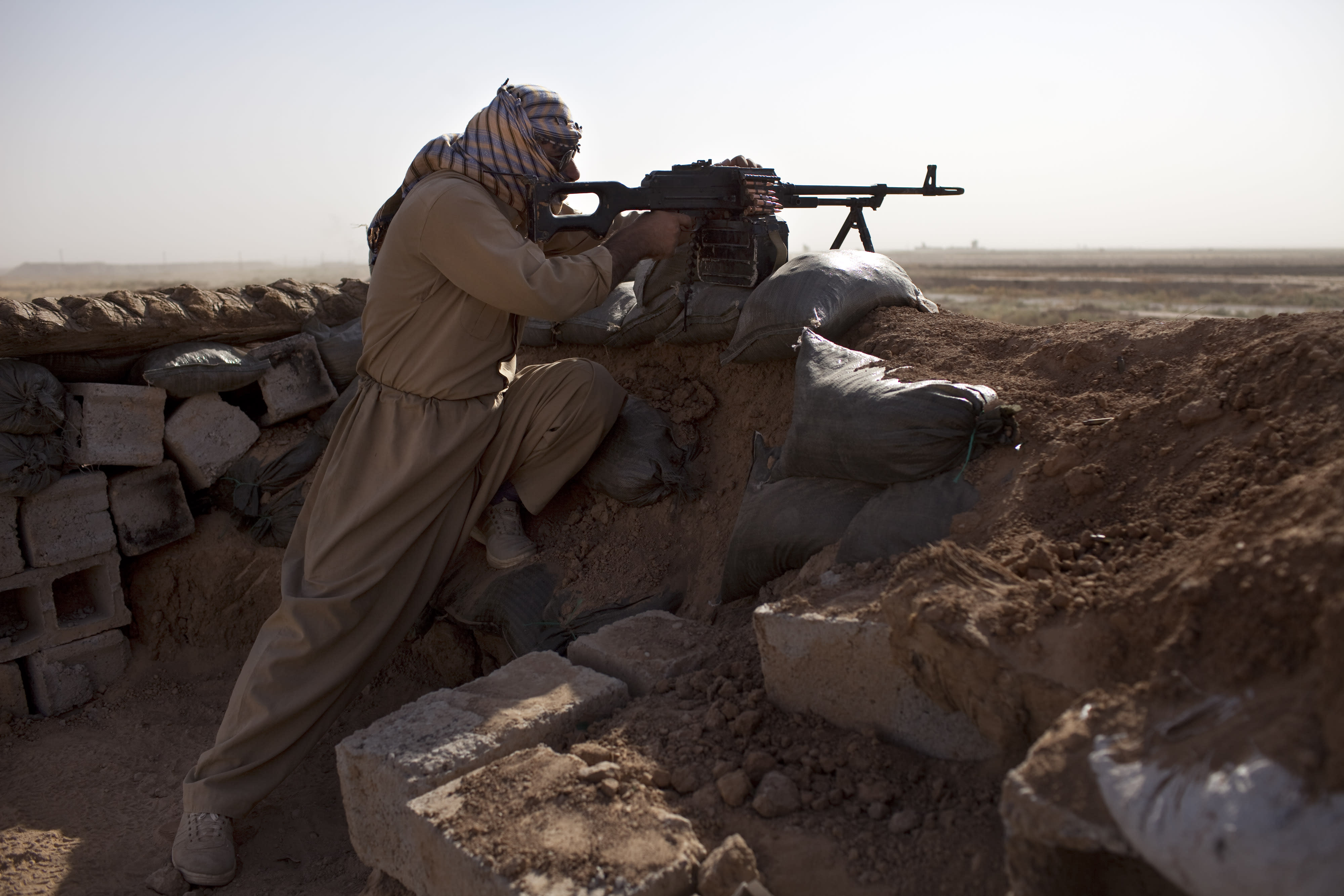 A Kurdish Peshmerga fighter guards the frontline during clashes against Islamic State (IS) militants in Yangije, on September 11, 2014 (AFP Photo/JM Lopez)