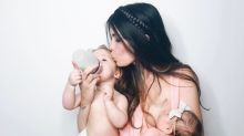 Viral photo shows a mum breastfeeding one baby while bottle feeding another