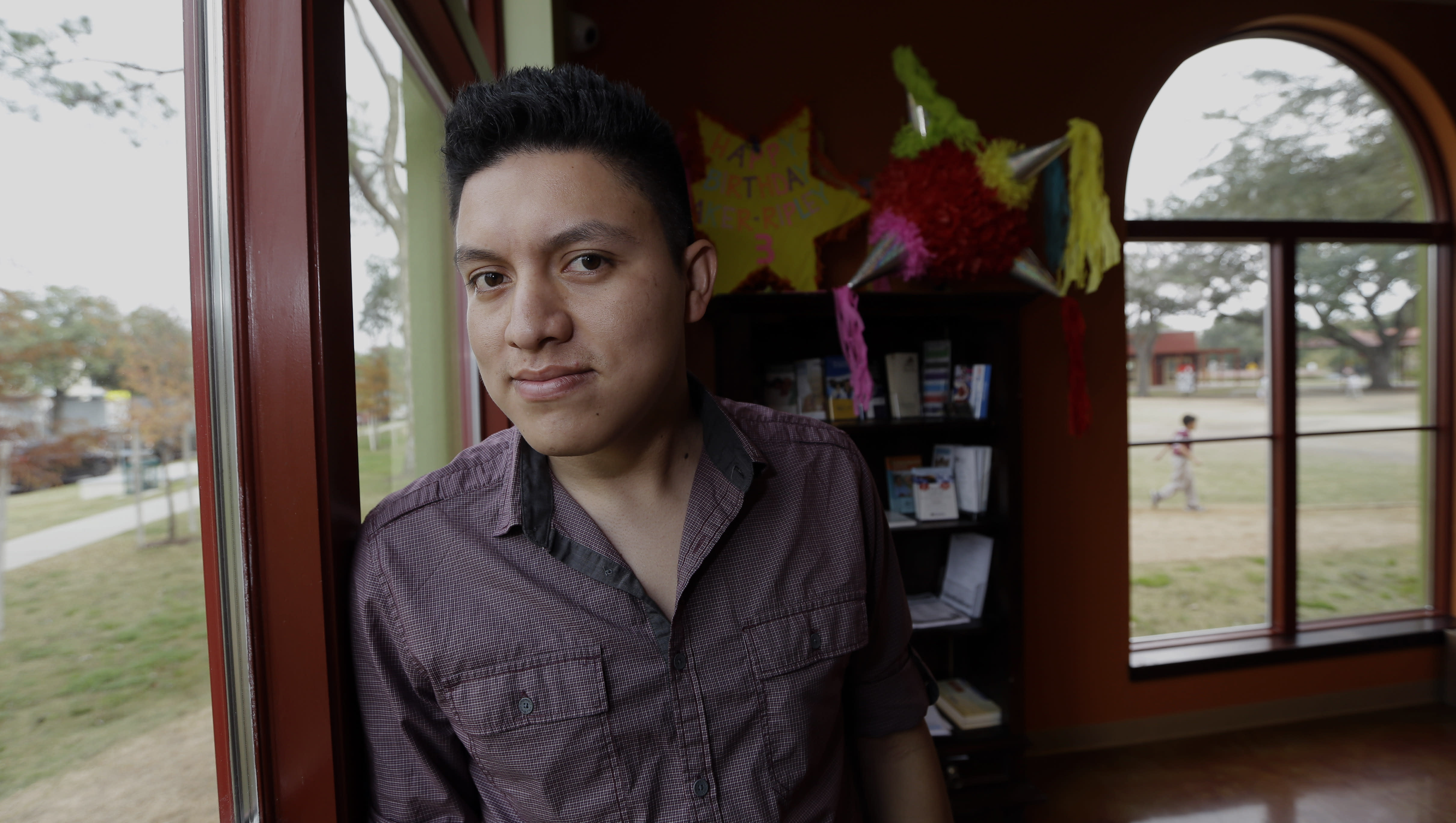 Manuel Enrique Angel, 28, of El Salvador, poses in Houston Wednesday, Dec. 4, 2013. Angel made learning English his first priority upon arriving in Houston from his native El Salvador two years ago. He now speaks English clearly and deliberately and plans to apply for citizenship as soon as he becomes eligible later this year. He estimates it will take him up to eight months to save the money for the citizenship application. (AP Photo/David J. Phillip)