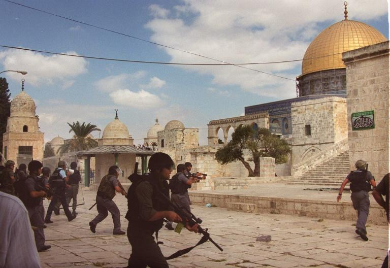 In this September 2000 photo, Israeli riot police take position inside Jerusalem's Al-Aqsa mosque compound during clashes with Palestinians