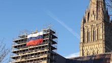 Russian flag unfurled on scaffolding at Salisbury cathedral, as locals condemn 'disrespectful' act