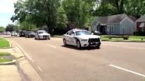 Massive funeral procession follows officer's funeral
