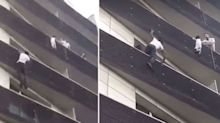 Daring man scales building to rescue dangling child