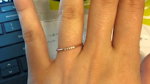 'He thinks it makes him look cheap': Bride-to-be defends her 'dainty' wedding band