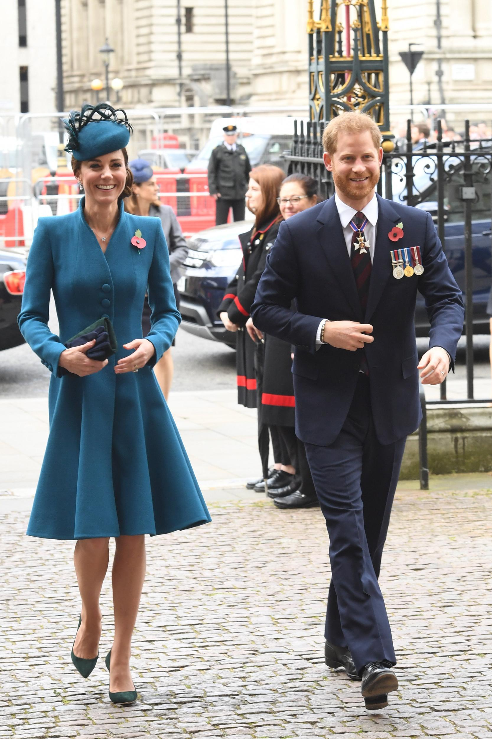 TOPSHOT - Britain's Catherine, Duchess of Cambridge, (L) and Britain's Prince Harry, Duke of Sussex, (R) arrive to attend a service of commemoration and thanksgiving to mark Anzac Day in Westminster Abbey in London on April 25, 2019. - Anzac Day marks the anniversary of the first major military action fought by Australian and New Zealand forces during the First World War. The Australian and New Zealand Army Corps (ANZAC) landed at Gallipoli in Turkey during World War I. (Photo by Jeremy Selwyn / AFP)        (Photo credit should read JEREMY SELWYN/AFP/Getty Images)