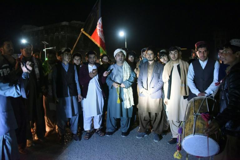 Peace activists gather in Kandahar to celebrate the partial truce, a potentially historic turning point in the war (AFP Photo/JAVED TANVEER)