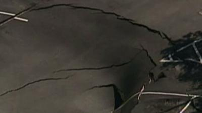 Raw: Sinkhole Collapses Fla. Parking Lot