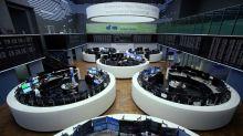 Global stocks edge lower on economic toll from coronavirus, oil rallies