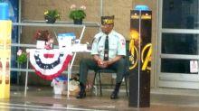 Walmart is under fire for making veteran sit outside in rain