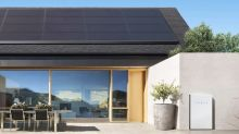 Walmart's lawsuit over solar panel fires is the latest 'tarnish' on Tesla, analyst says