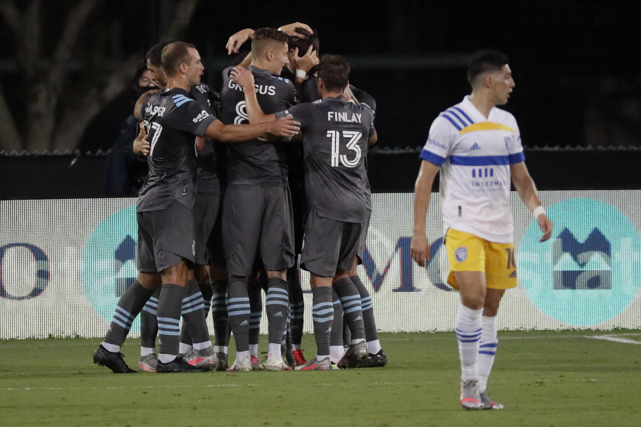 Minnesota United midfielder Robin Lod celebrates his goal as San Jose Earthquakes forward Cristian Espinoza walks off during the first half of an MLS soccer match, Saturday, Aug. 1, 2020, in Kissimmee, Fla. (AP Photo/John Raoux)