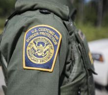 US Border agent accused of hitting migrant with truck after using racial slurs