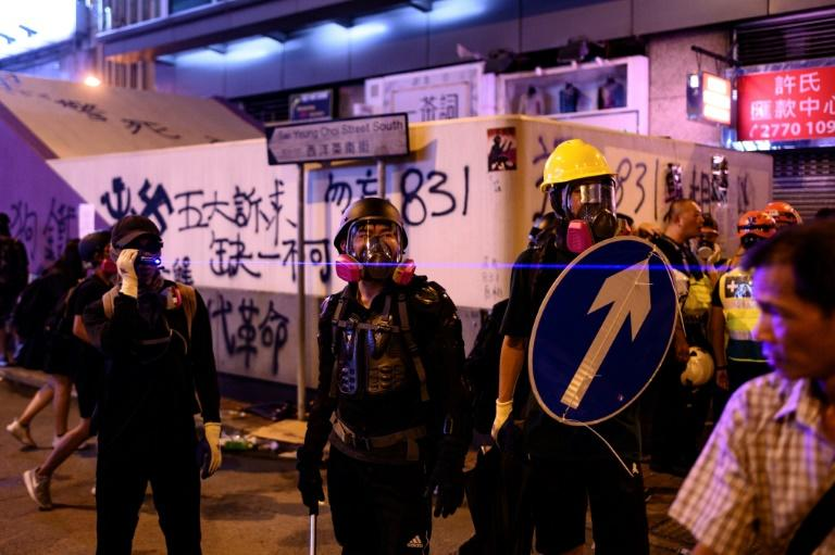 Hong Kong has faced months of protests, and demonstrators in the city appealed to the German chancellor to support them in her meetings with China's leadership (AFP Photo/Philip FONG)