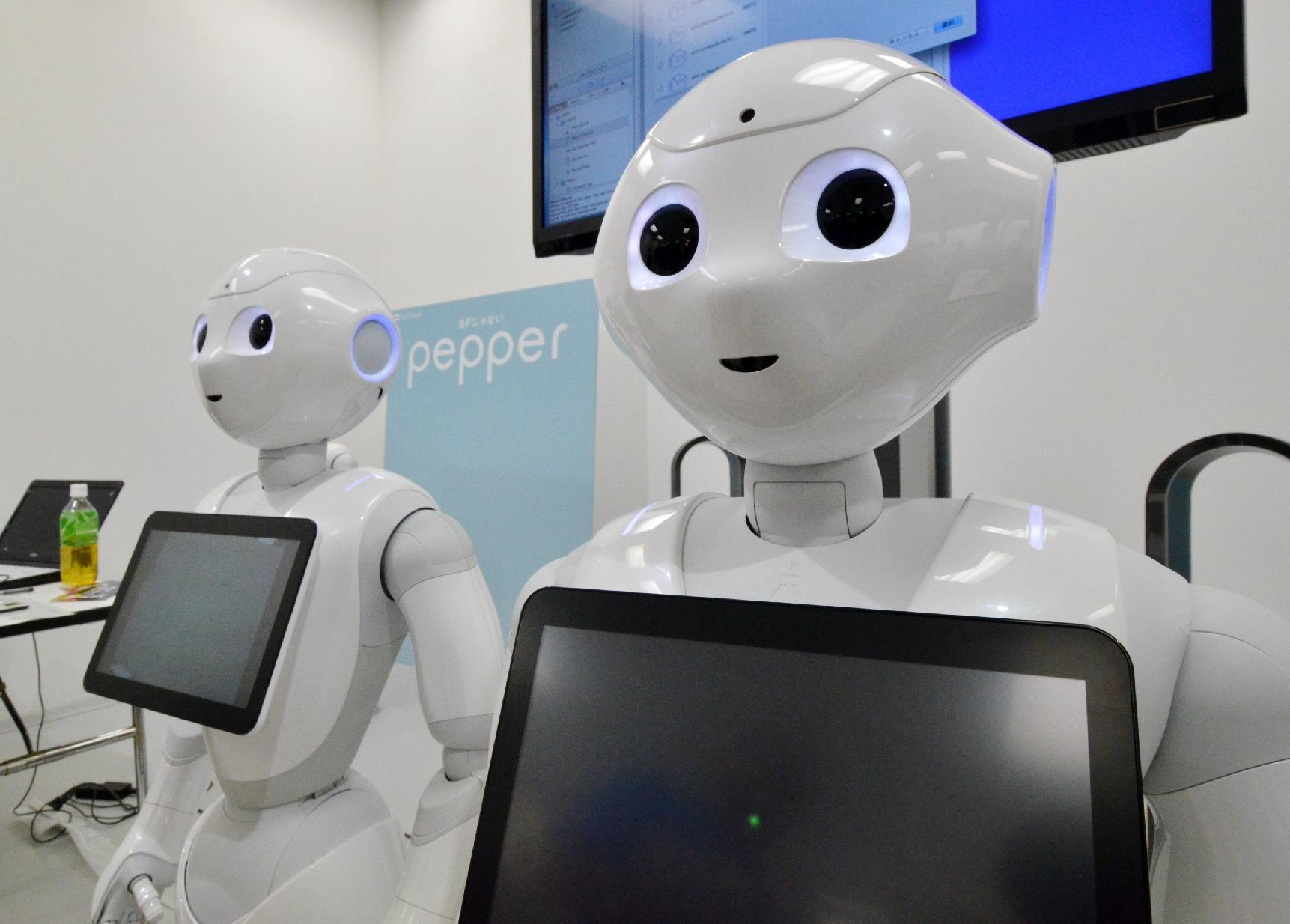 """Softbank's humanoid robot """"Pepper"""" is displayed at a high-tech gadgets exhibition in Tokyo"""
