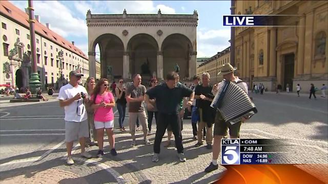 Reporter Attempting Chicken Dance in Germany