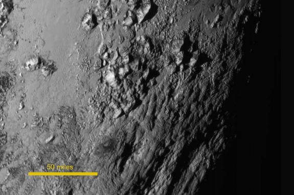 Ice mountains about 11,000 feet (3,500 meters) high — but no obvious craters — are visible in this photo, which was captured by NASA's New Horizons spacecraft on July 14, 2015 from a distance of 47,800 miles (77,000 kilometers).