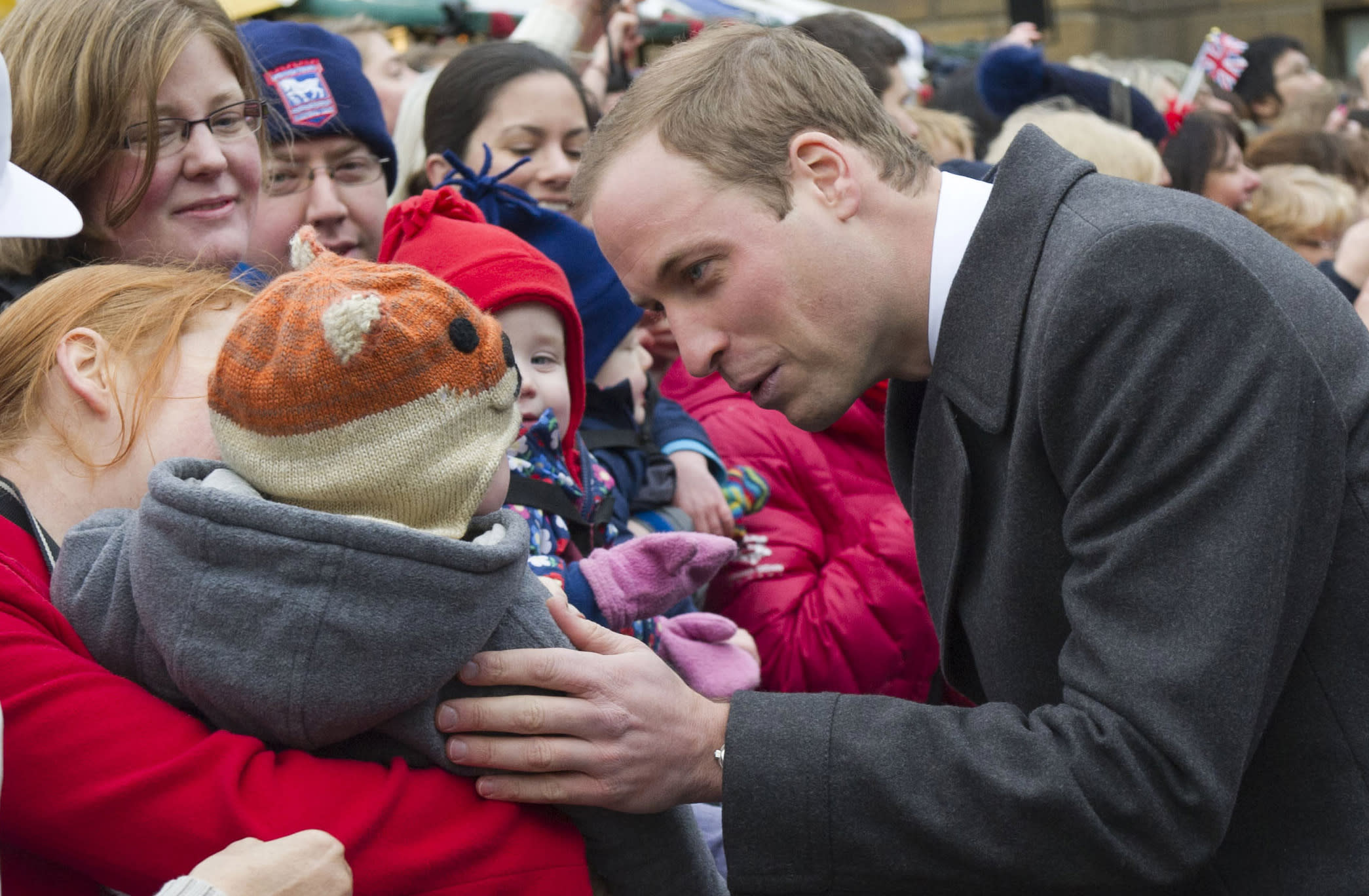 FILE - In this Wednesday Nov. 28, 2012 file photo Britain's Prince William meets with a young member of the public as she arrives at the Guildhall during a visit to Cambridge England. The Duke and Duchess of Cambridge are very pleased to announce that the Duchess of Cambridge is expecting a baby, St James's Palace officially announced Monday Dec. 3, 2012. (AP Photo/Arthur Edwards, File)