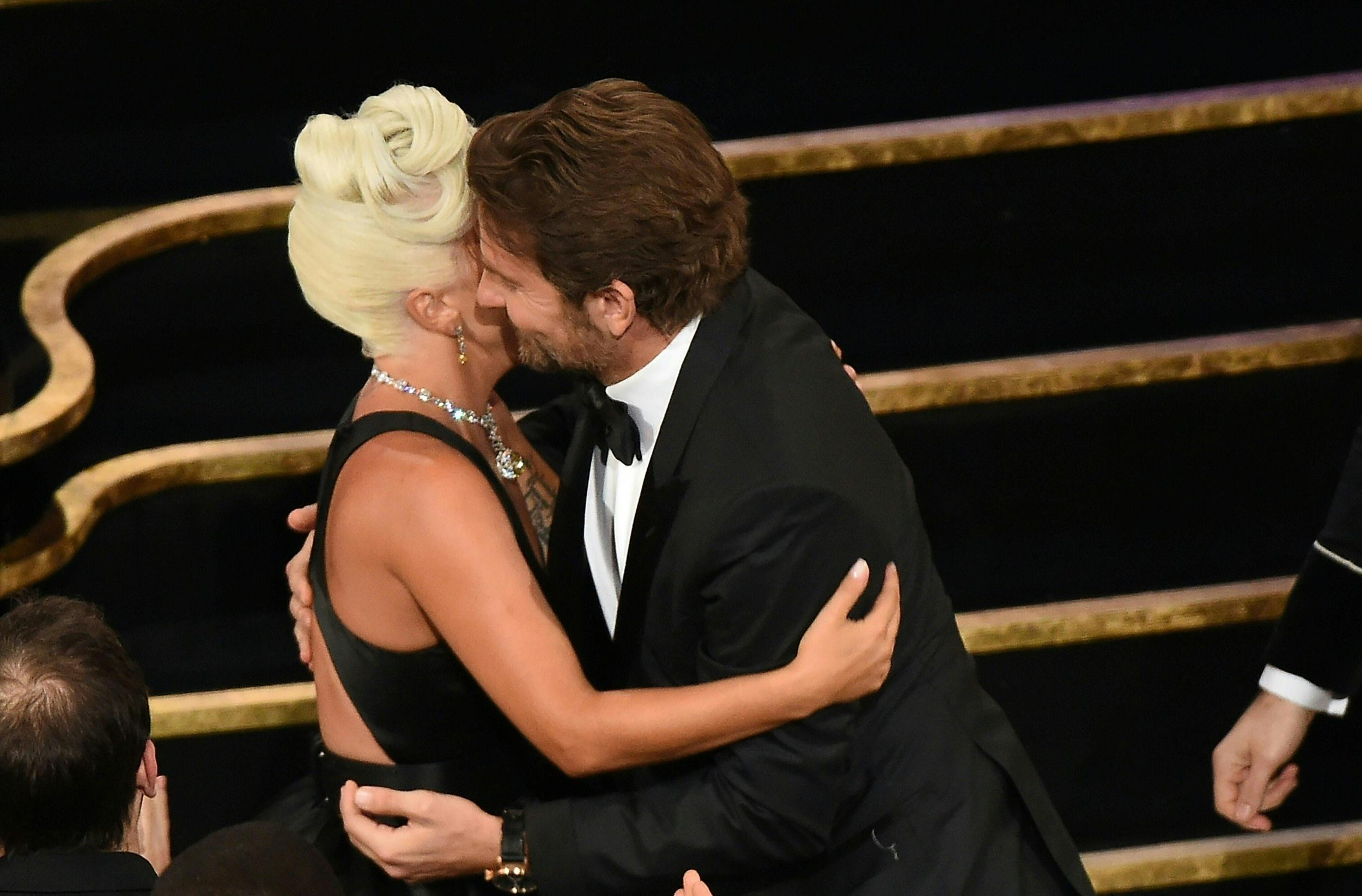 Best Original Song nominees for 'Shallow' from 'A Star is Born' Lady Gaga embraces actor Bradley Cooper (R) as she accepts the award for Best Original Song during the 91st Annual Academy Awards at the Dolby Theatre in Hollywood, California on February 24, 2019. (Photo by VALERIE MACON / AFP)        (Photo credit should read VALERIE MACON/AFP/Getty Images)