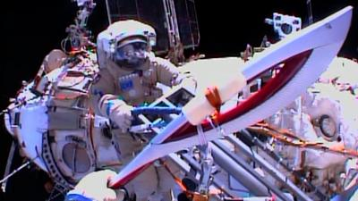Raw: Spacewalkers Hand Off Olympic Torch