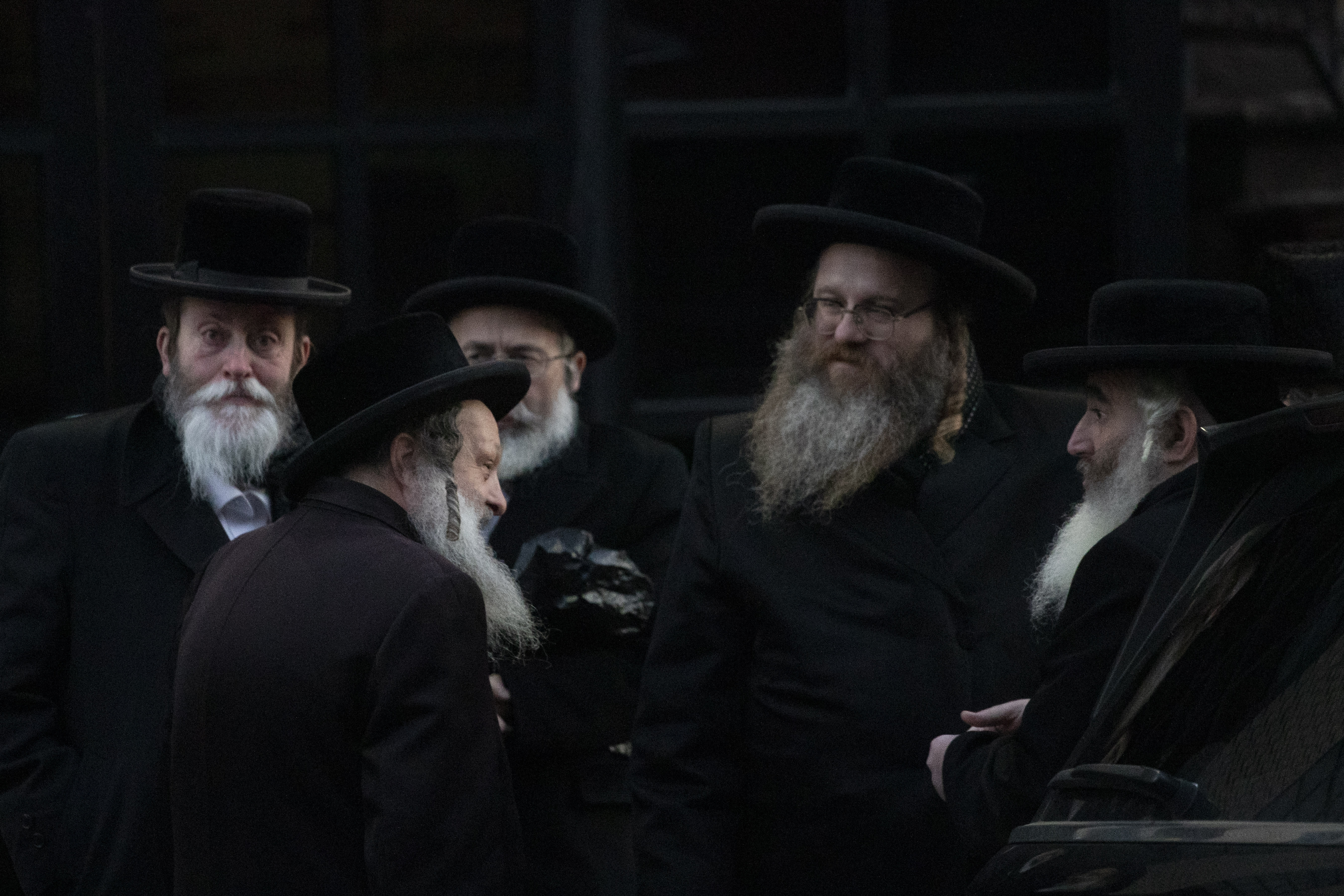 Orthodox Jewish men gather outside a Brooklyn synagogue prior to a funeral for Mosche Deutsch, Wednesday, Dec. 11, 2019 in New York. Deutsch, a rabbinical student from Brooklyn, was killed Tuesday in the shooting inside a Jersey City, N.J. market. (AP Photo/Mark Lennihan)