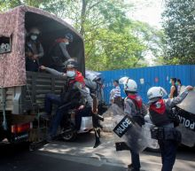 Myanmar police fire into air to disperse protests as lawyer to Suu Kyi says access denied