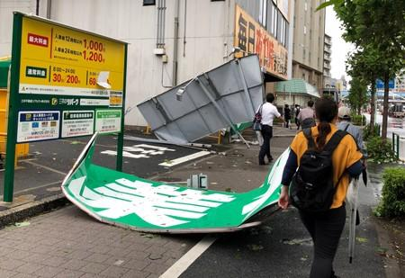 Collapsed steel advertising boards caused by Typhoon Faxai are seen at Edogawa ward in Tokyo, Japan