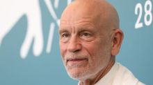 John Malkovich says a woman once broke into his home to give him a film script handwritten in blood