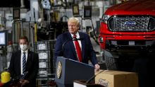Trump visits Ford plant in politically crucial Michigan, leaves mask off for cameras