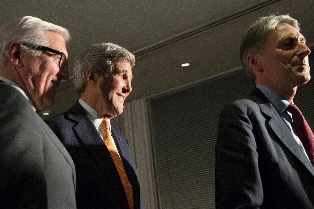 British Foreign Secretary Philip Hammond (R) leads German Foreign Minister Frank Walter Steinmeier (L) and U.S. Secretary of State John Kerry away from the microphones after mking a statement about their meeting in London, on March 21, 2015 (AFP Photo/Brian Snyder)