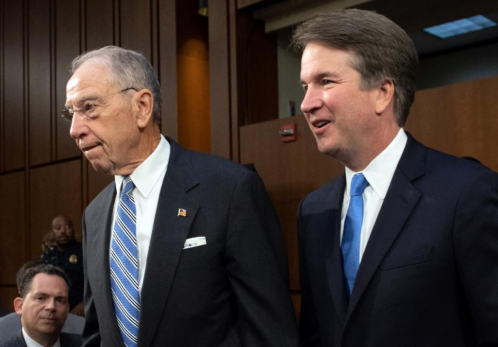 Supreme Court nominee Brett Kavanaugh, alongside Senator Chuck Grassley, attends a confirmation hearing in the US Senate on Capitol Hill