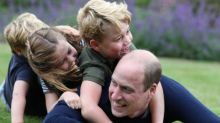 Prince William is a picture of normality while play-wrestling with his children in new photo