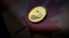 Canadian dollar hits nine-day low before paring losses on trade optimism
