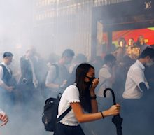 Hong Kong police shoot protester as pro-democracy unrest spiralsinto rare working-hours violence
