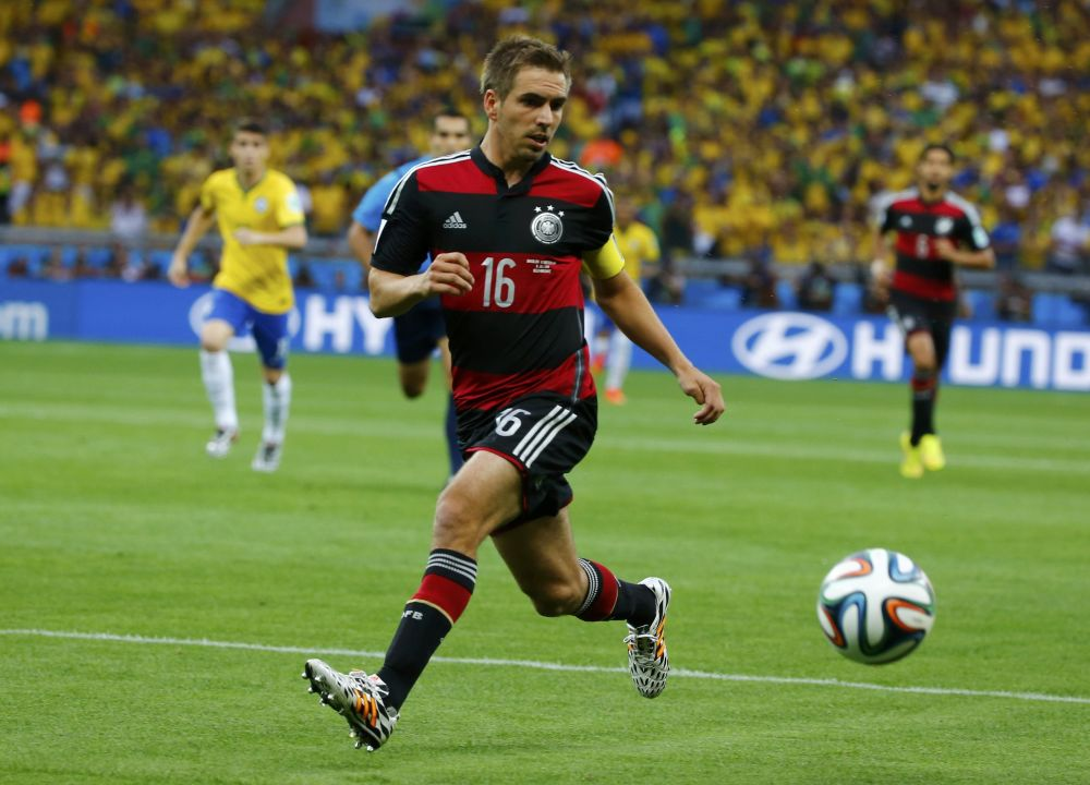 Germany's Lahm runs to intercept the ball during their 2014 World Cup semi-finals against Brazil at the Mineirao stadium in Belo Horizonte